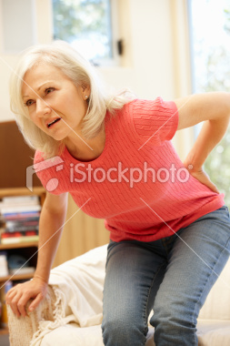 Stock-photo-18349747-mid-age-woman-with-backache